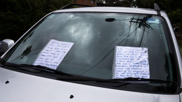 An exchange of notes left on a car parked on the side of the road in a completely legal spot indicates the rising level ...