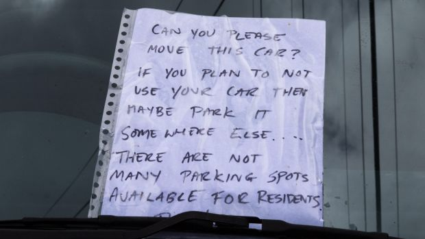Parking mad: A lively written exchange unfolded between two neighbours on the windscreen of one vehicle.