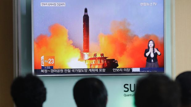 Anxious South Koreans watch footage of a North Korean ballistic missile launch last year