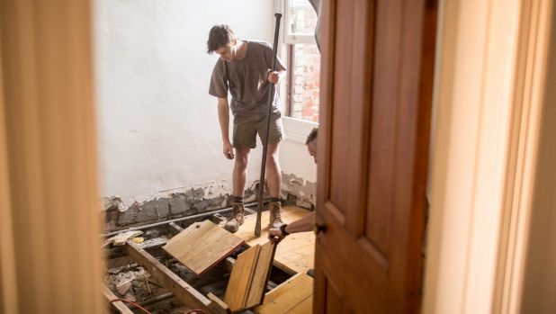 A householder takes drastic action to combat a termite infestation.