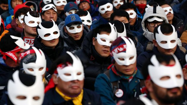 South Korean protesters attend an anti-government rally in downtown Seoul.