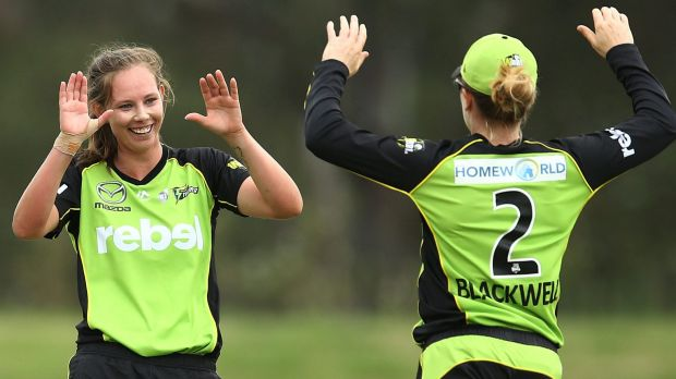 Breakthrough: Sam Bates celebrates with Alex Blackwell after taking the wicket of the Heat's Delissa Kimmince at ...