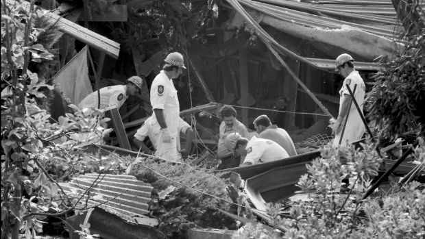 Police examine the remains of Richard Gee's Belrose house in 1984 after it was bombed.