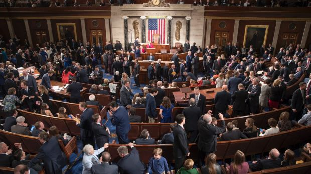 Members of the House of Representatives, some joined by family, gather as the 115th Congress gets under way in ...