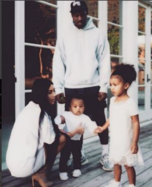Kardashian West with husband Kanye West and their children, North and Saint.