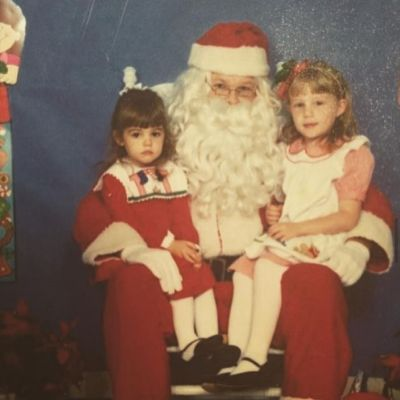 Lucy Hale shared this picture of her unimpressed self sitting on Santa's knee for the holiday season.