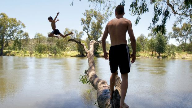 Learning to swim in the Murray River.