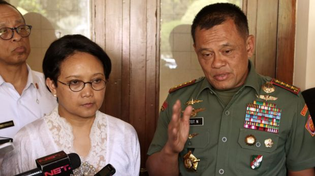 Indonesian Armed Forces Chief General Gatot Nurmantyo, right, speaks to the media as Foreign Minister Retno Marsudi, ...