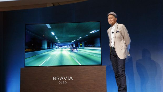 Kazuo Hirai, president and chief executive of Sony, stands next to a Sony XBR-A1E Bravia OLED 4K HDR.
