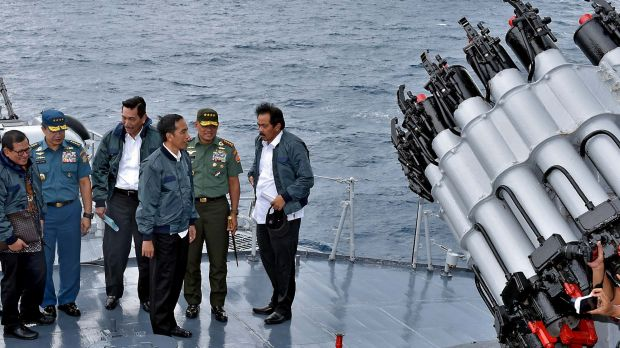 Indonesian President Joko Widodo, third from right, on the deck of an Indonesian navy warship in the waters of the ...