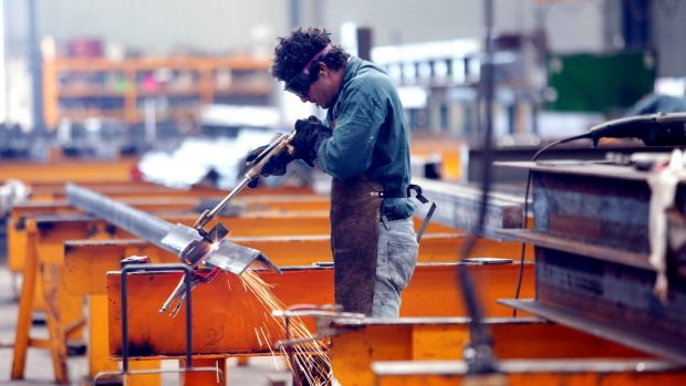 """A welder working on a steel beam: Blue-collar professions like this are considered jobs for """"real men""""."""