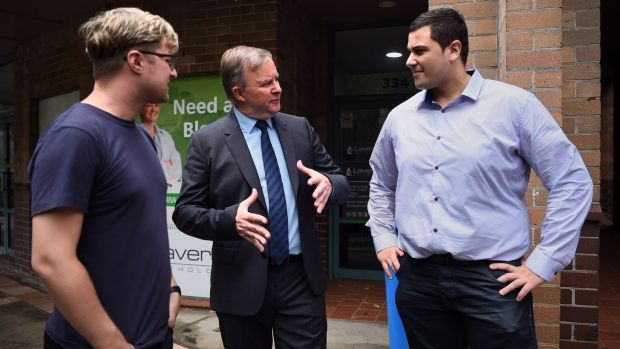 Anthony Albanese (centre) in front of his Marrickville office, Sydney, with two locals affected by the Centrelink debt ...