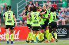 Canberra United celebrate captain, Ashleigh Sykes goal against Adelaide United.