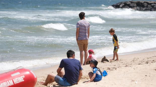 Beachgoers at Elwood stick to the sand.
