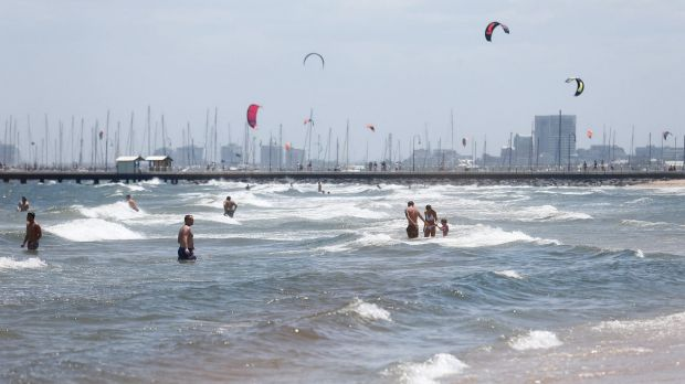 Swimmers enjoy the sun and surf at St Kilda beach where there was a shark alert on Sunday.