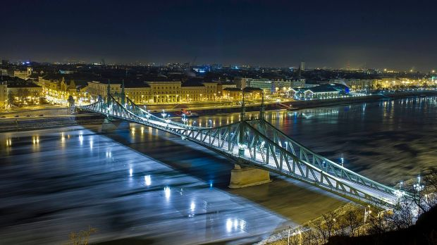 In this picture taken with a long time exposure, drift ice or ice floes float in the water of River Danube at the ...