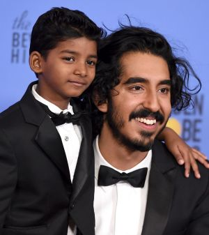Sunny Pawar, left, and Dev Patel pose in the press room at the 74th annual Golden Globe Awards