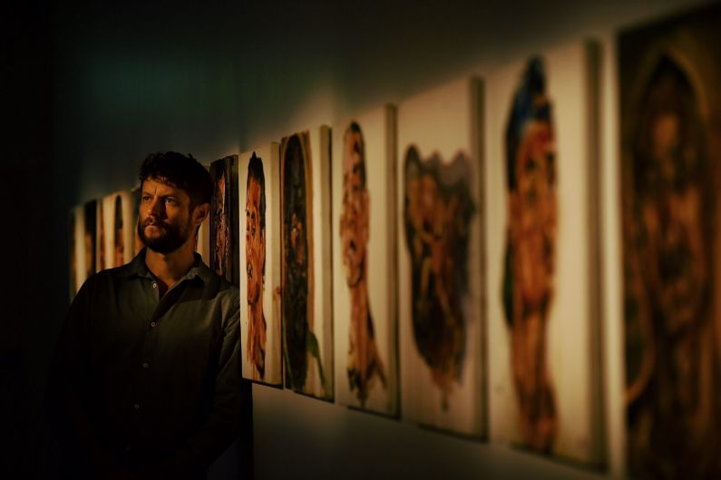 Artist Ben Quilty with some of Myuran Sukumaran's paintings that are a part of 'Another Day In Paradise' an exhibition ...
