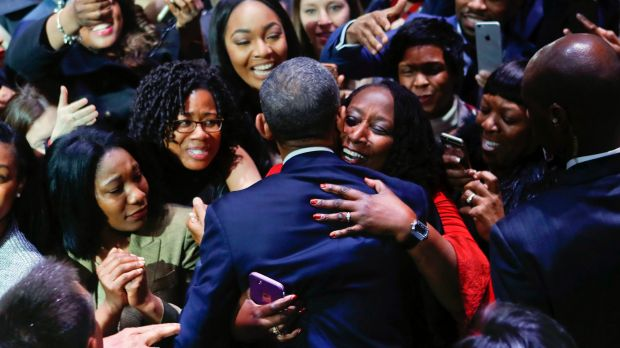 President Barack Obama is embraced by a woman in the crowd as he greets supporters after his farewell address.