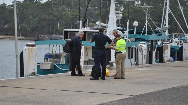 Alan Langdon speaks with Australian Border Force officials at Ulladulla Harbour.
