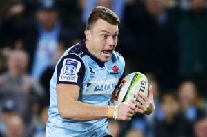 SYDNEY, AUSTRALIA - MAY 27: Jack Dempsey of the Waratahs charges towards the line to score a try during the round 14 ...