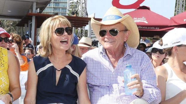 Gerry Harvey, with wife Katie, got hit with a double-whammy.