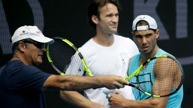 Spain's Rafael Nadal (right) with his uncle Toni Nadal (left) as Carlos Moya looks on.