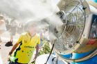 Children cool off under misting fans during day 1 of the Australian Open.