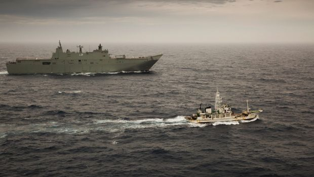HMAS Adelaide escorts the former Japanese whaling vessel towards Hobart in December.