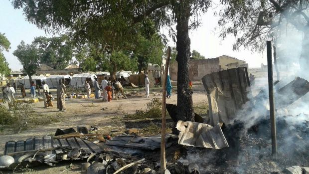 In this image supplied by the aid group Medecins Sans Frontieres, smoke rises from a burnt-out shelter at a camp for ...