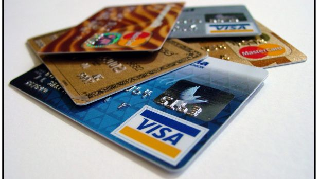 Three men have been charged with a number of offences involving allegedly cloned credit cards.