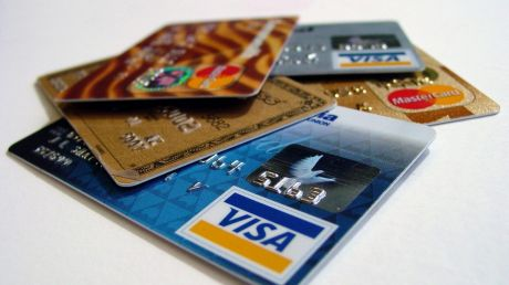The big banks are all trimming their credit card reward programs but fees are rising.