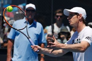 Split: Andy Murray training in Melbourne as Ivan Lendl watches in the background.