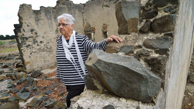 Laura Bell walks through the ruins at the Aborginal Mission station at Lake Condah in 2015.