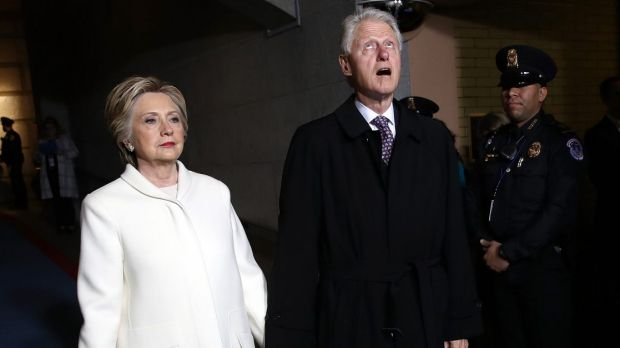 Hillary Clinton, left, and former U.S. President Bill Clinton arrive during the 58th presidential inauguration on January 20.