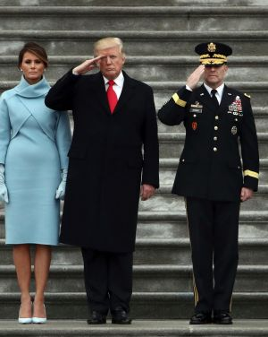 President Donald Trump with first lady Melania Trump and Major General Bradley Becker review troops in Washington.