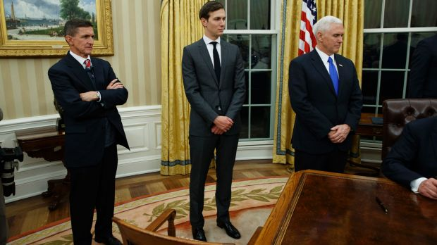 Jared Kushner, flanked by National Security Adviser Michael Flynn (left) and US Vice-President Mike Pence, watches his ...