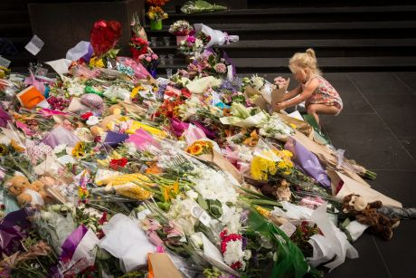 Hundreds of bunches of flowers were laid in Bourke Street in the wake of the tragedy.