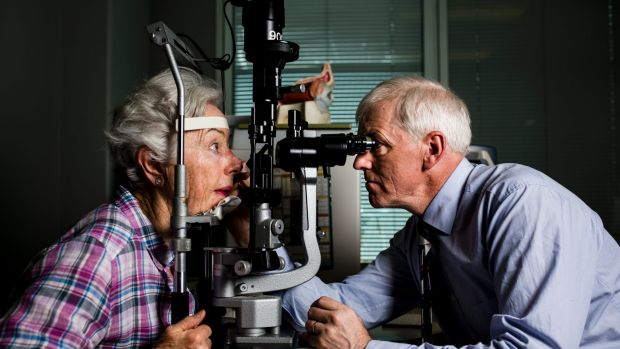 Optometrist Dr Mark Feltham with patient Patricia White of Bruce. The ACT has a shortage of new optometrists, according ...