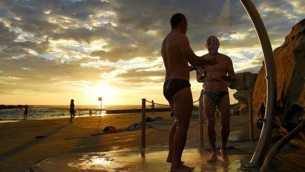 Swimmers rinse off after a swim at Clovelly Beach earlier this month.