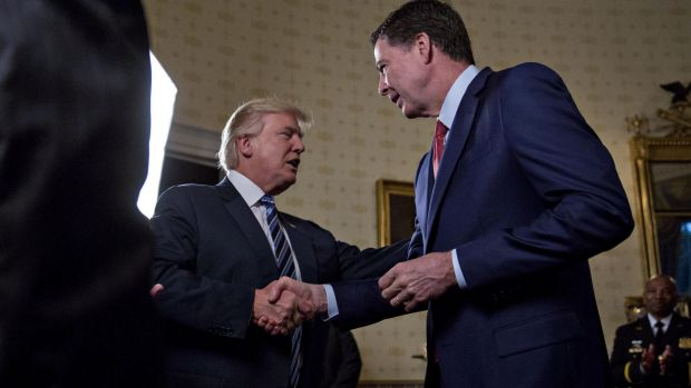 President Donald Trump greets then-FBI director James Comey with a handshake back in February.