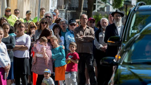 Mourners gather over the Bourke Street death of 10 year old Thalia Hakin