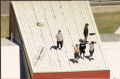 Youths on the roof of the Malmsbury Justice Centre.