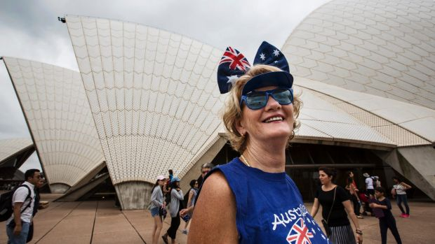 A woman celebrates Australia Day by the Sydney Opera House on January 26, 2017.