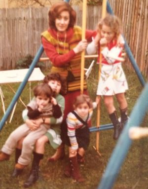 Gladys Berejiklian, in green, holds her cousin Sima, with her Aunty Sonya, her sisters Mary and Rita.