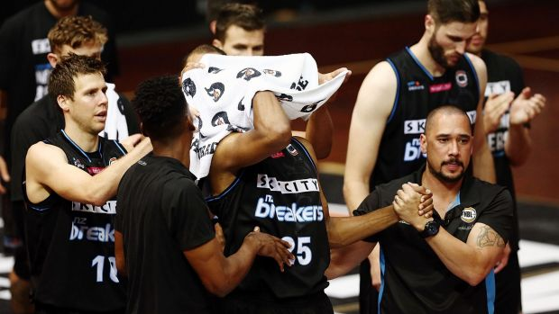 Breakers players applaud Akil Mitchell as he is helped off the court after suffering a serious eye injury on Thursday night.