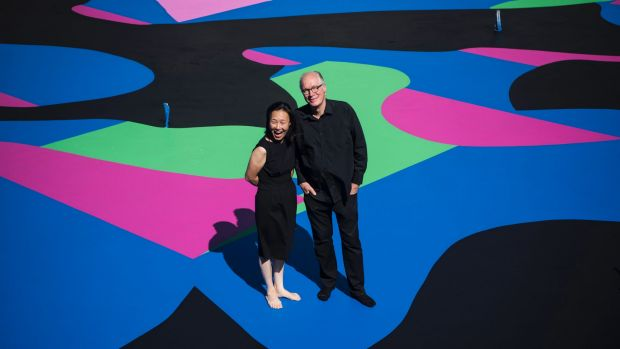 Architect and arts patron Corbett Lyon with his wife Yueji standing on Reko Rennie's <i>Visible Invisible</i>, painted ...