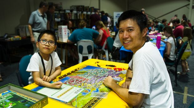 Ronald and Chilok Yu, 6, of Gungahlin play Power Grid from the board game library.