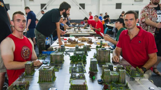 Sam Allan of Maitland and Geoff Orton of Brisbane take part in the miniatures gaming.