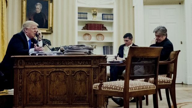 Donald Trump with then-national security adviser Michael Flynn and chief strategist Steve Bannon during a phone call ...